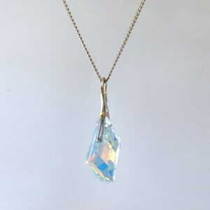 Rhodium plated Silver Necklace with a Crystal AB angular shaped Swarovski crystal. Retha Designs