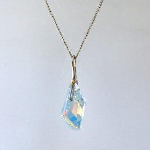 Rhodium plated Silver Necklace with a Crystal AB angular shaped Swarovski crystal. Retha Designs