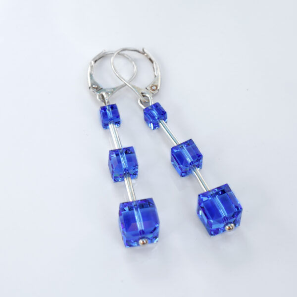Closed-clip-dangle-earrings-made-with-Sterling-Silver-and-Sapphire-coloured-Swarovski-crystal-cubes-Retha-designs