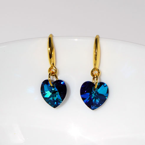 Earwire 24k gold plated .925 silver earrings - 10mm Bermuda Blue coloured Swarovski crystal hearts. Retha Designs