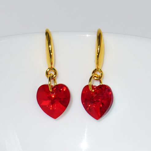 Earwire 24k gold plated .925 silver earrings- 10mm Siam coloured Swarovski crystal hearts. Retha Designs