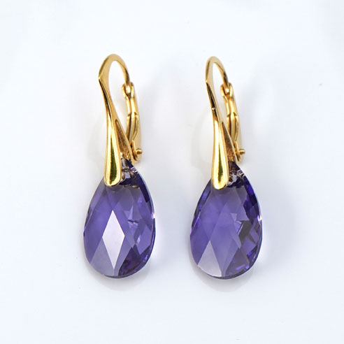 Gold plated silver earrings with small Tanzanite Teardrop Swarovski crystals. Retha Designs