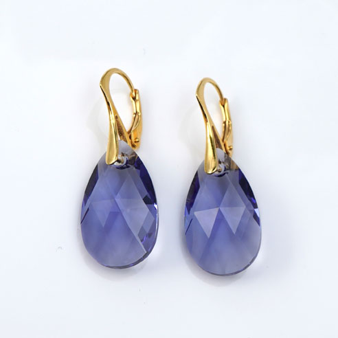 Gold plated silver earrings with large Tanzanite Teardrop Swarovski crystals. Retha Designs