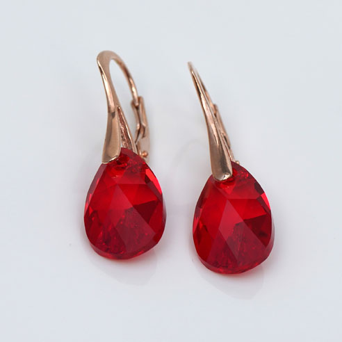 Rose Gold plated silver earrings with small Ruby Red Pear shaped Swarovski crystals. Retha Designs