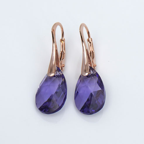 Rose Gold plated silver earrings with small Tanzanite Teardrop Swarovski crystals. Retha Designs