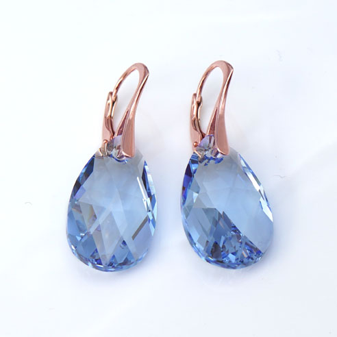 Rose Gold plated silver earrings with large Light Sapphire Teardrop Swarovski crystals. Retha Designs