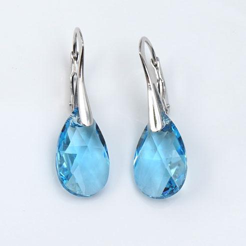 Rhodium plated silver earrings with small Aquamarine Teardrop Swarovski crystals. Retha Designs