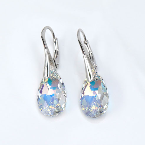 Rhodium plated silver earrings with small Clear Pear shaped Swarovski crystals. Retha Designs