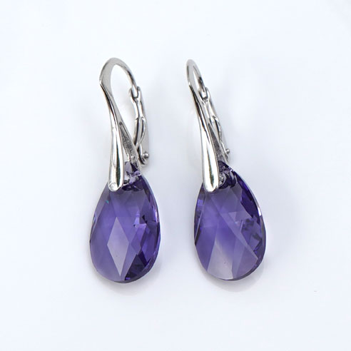 Rhodium plated silver earrings with small Tanzanite Pear shaped Swarovski crystals. Retha Designs