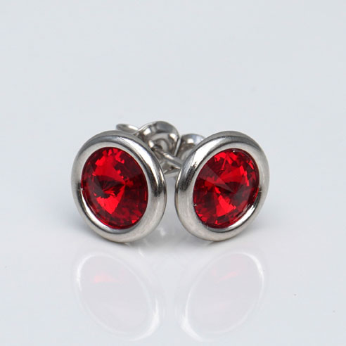 White Rhodium Plated .925 Silver stud earrings crafted with Light Siam (Ruby Red) Swarovski® crystal. July birthstone jewellery.