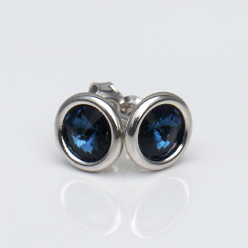 White Rhodium Plated .925 Silver stud earrings crafted with Montana (blue) colored Swarovski® crystal. December birthstone jewellery.
