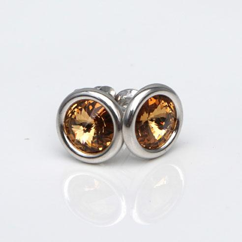 Sterling Silver stud earrings crafted with Topaz Swarovski® crystal. November Birthstone jewellery. Retha Designs