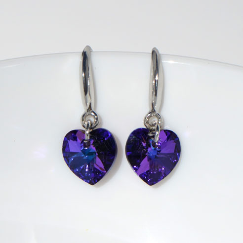 Rhodium plated silver wire earrings with purple Swarovski crystal hearts. Retha Designs